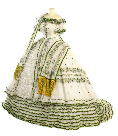 Embroidered evening dress and matching stole, German, 1854. Part of the trousseau of Empress Elisabeth of Austria. It is astonishing that the dressmaker was able to achieve such full skirts before the dome-shaped cage crinoline was invented (earlier cage crinolines created more of a cone shape).