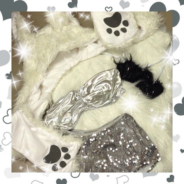 Today's Turn Up Tuesday Outfit features our White Rabbit Furry Hood, Sparkle White Fluffies, Non-Slip White Leg Wraps, Sequin Silver Shorts, and Silver Metallic Bandeau Top!