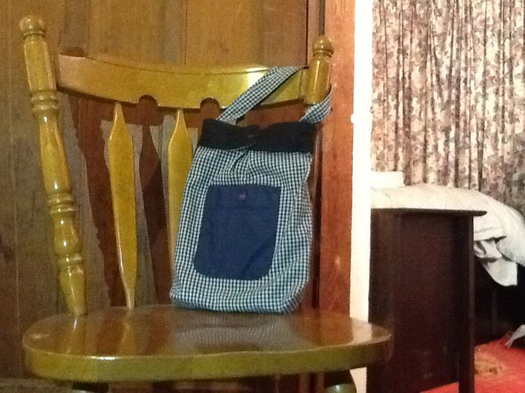 Small over the shoulder bag. This bang was made from two old shirts, using both navy blue and black. Decoration includes buttons and  2 pleats, on at the front and other at the back. All up this took about 4 hours including drawing up the pattern.