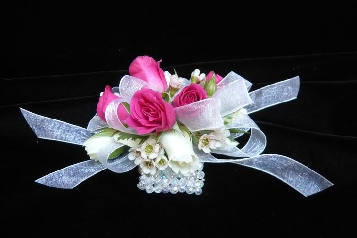 Hot pink and white spray rose on white sheer ribbons and a crystal bracelet. Wrist #corsage for #prom by Emil J Nagengast Florist in Albany, NY