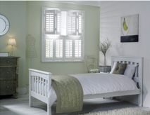 White Bedroom Double Shutters by Apollo Blinds. Neutral home decor ideas. Bedroom shutters. Modern window dressing. Contemporary home decor inspiration for the bedroom.