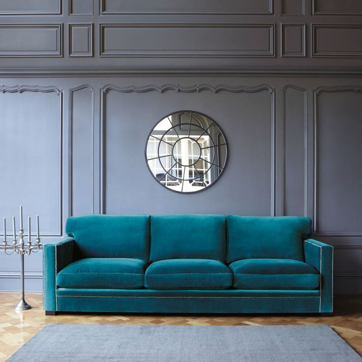 $1800    Sofa in blue velvet, seats 4/5 DANDY  Ref. 123687     Dimensions (cm) : H 88 x W 263 x D 95   Weight : 80 Kg    Upholstery : 100% cotton velvet with Teflon anti-stain treatment, in teal blue  Frame : Pine and plywood  Legs crafted from wenge-stained pine, satin-finish nitrocellulose varnish        Elastic webbing suspension  Studs on front and aged metal armrests     - 2 years for back cushion and seat cushion stuffing.  - 1 year for sofabed upholstery and mattresses.Eco-certified…