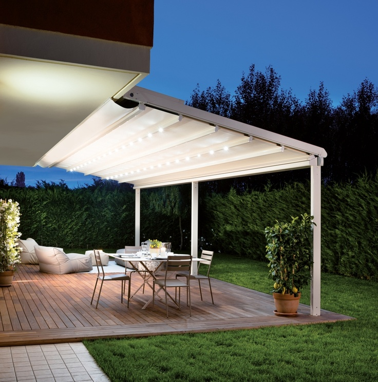 Pergole Unica 130, pergole retractabile Gibus pentru terase, optional incorporeaza in profile sisteme de iluminat led-light. Imagine pergola terasa nocturna,unica 130 focus.