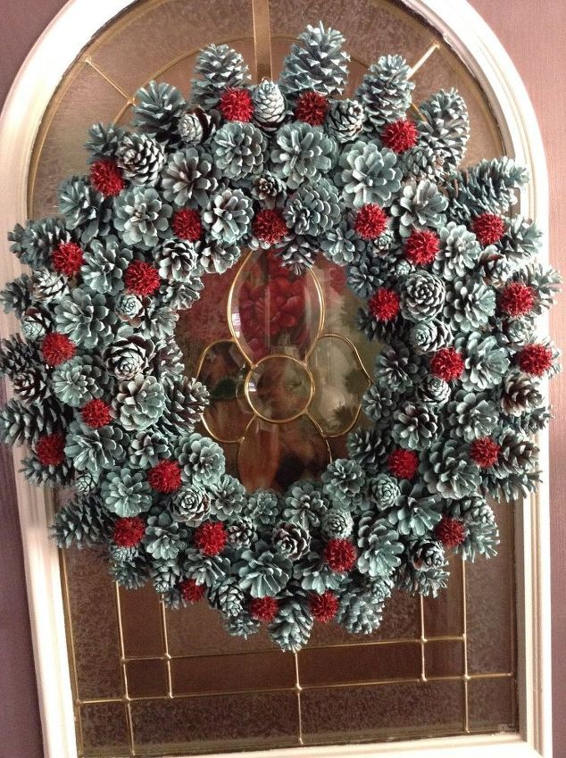 pine cone wreath with spray painted pine cones and sweet gum balls.