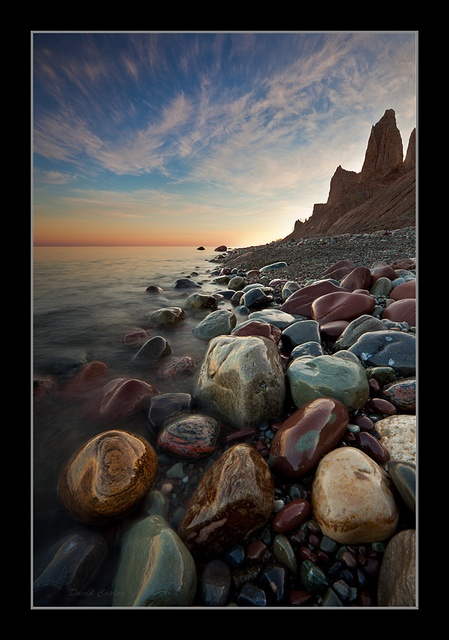 Chimney Bluffs State Park, Wolcott, NY.   Land and water clash at Chimney Bluffs, sculpting the most dramatic landscape on the Lake Ontario shore. You can experience massive earthen spires from above or along the lakeshore on nature trails.