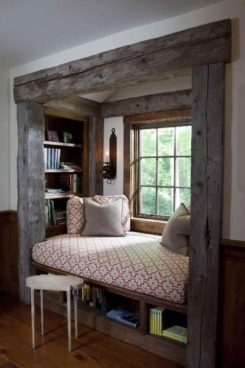 I absolutely love this reading nook!    Rustic heavy timber beams, a comfy place to relax, storage for your reading matter, a place to put your coffee (or glass of wine), good natural light ..........    Am I wrong, or is this beautiful space.    Let me know by commenting and Repinning...