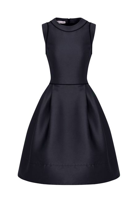 New in for AW13 this fabulous retro style dress is packed with charm and full of 1950s spirit. A wonderful deep Navy Blue dress with black contrast. A unique, cool playful silhouette with a modern perspective Flattering silhouette with a close fitting bodice which is waisted and then kicks out into a fun full skirt part.. As worn by Martha Ward of British Vogue.com to present Royal Ascot