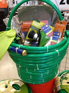 "Gardening ""basket"" out of garden hose and filled with essentials."
