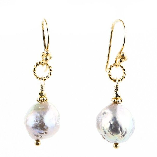 These pearl solitaire earrings are an updated take on classic pearls with their organic Baroque shape and luxuriant coloring. Accents of warm 22k gold vermeil bring out the subtle purple and peacock hues in these pearls, creating a pair that is as earthy as it is glam—and gorgeous against every skin tone! - Robindira Unsworth