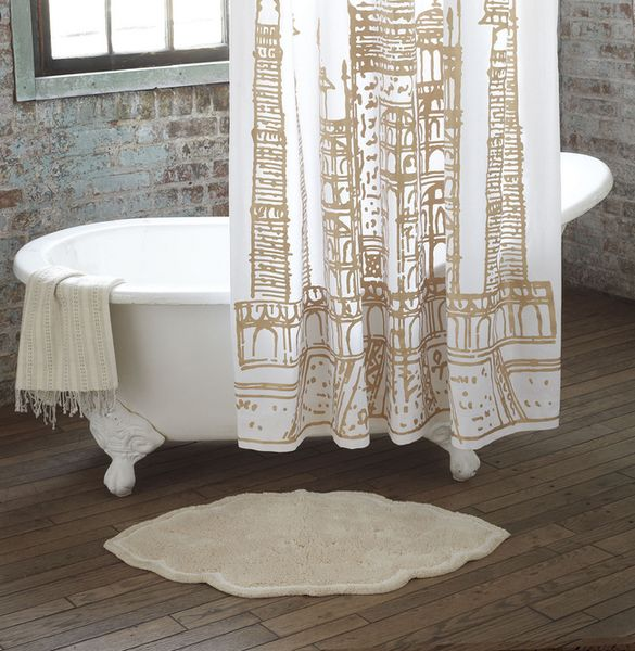 gold and white Taj Mahal shower curtain in brick bathroom with wood floors...Sophisticated Fall Shower Curtains for Guest Bathrooms from The Bathroom Bliss Blog by Rotator Rod