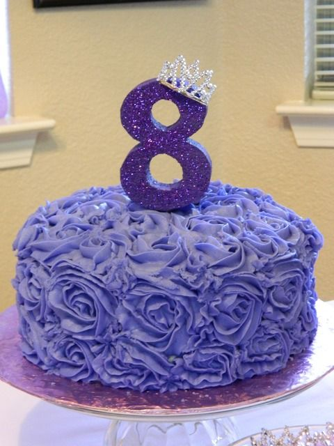 Purple rosette cake and an 8 with a tiara at a Sofia the First party.   See more party ideas at CatchMyParty.com.  #sofiathefirstpartyideas