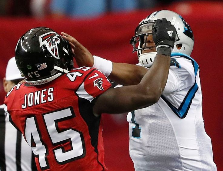 Atlanta Falcons outside linebacker Deion Jones (45) makes contact with Carolina Panthers quarterback Cam Newton (1) during the first half of an NFL football game, Sunday, Oct. 2, 2016, in Atlanta.