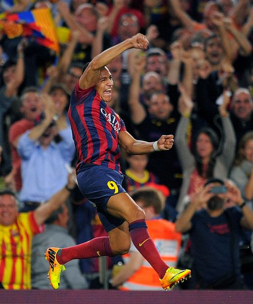 Alexis Sanchez of FC Barcelona celebrates after scoring his team's 2nd goal during the La Liga match between FC Barcelona and Real Madrid CF at Camp Nou stadium on October 26, 2013 in Barcelona, Catalonia.