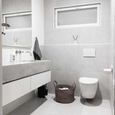 Tyylikäs betoni ja vaaleanharmaat sävyt luovat kylpyhuoneeseen modernin sekä valoisan ilmeen