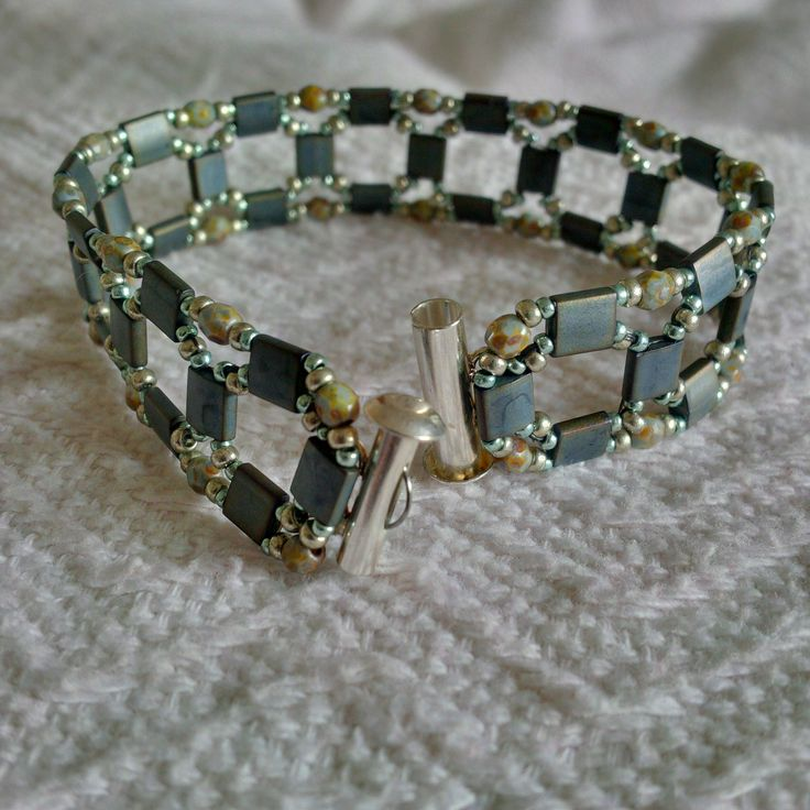I really like this bracelet, a lot. I love the simple, open feel of it. Most beading patterns have rounded or curved thread paths due to the nature of thread. I watched a tutorial on youtube (From ...