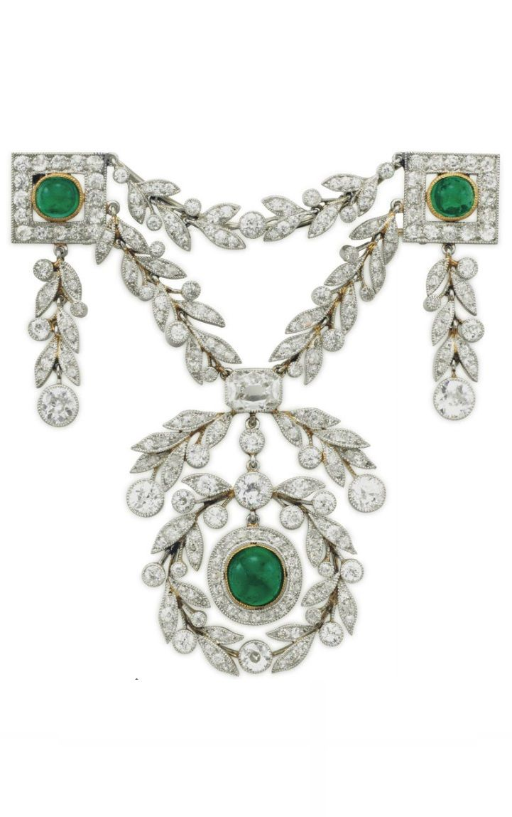 A BELLE EPOQUE DIAMOND AND EMERALD BROOCH, CIRCA 1900. The garland-style swag brooch with three collet-set cabochon emeralds, within old-cut diamond surrounds, to the old-cut diamond foliate details, 2 7/8 ins., mounted in platinum-topped gold. #BelleEpoque