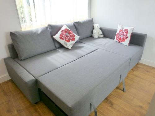 IKEA sofa w/ chaise pulls out into a full-size bed. AND the chaise lifts up for storage! I laid on this in the store...heavenly. I've wanted one forever!