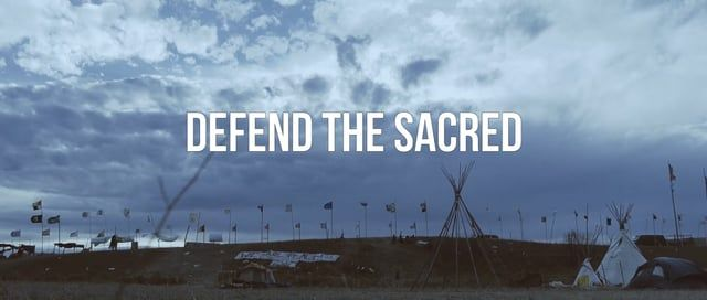 "Capturing the heart of a movement that is constantly evolving is difficult. How do you capture Spirit?   ""Defend The Sacred"" is a short documentary that attempts to capture the spirit of Indigenous people at Standing Rock.   Directed:  Kyle Bell Produced:  Adam Beach & Kyle Bell Executive Producers: Summer Tiger & The NTVS  Cinematography // Edited: Kyle Bell  Behind The Scenes Blog:  http://kylebellfilms.com/bts-blog"