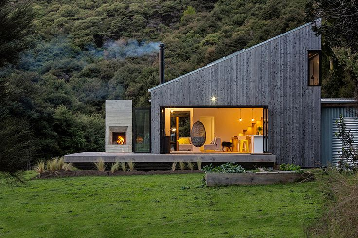 New Zealand's backcountry huts inspired this breezy, open home - Curbedclockmenumore-arrow : Indoor-outdoor living at its finest