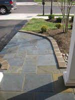 Custom concrete and flagstone ramp