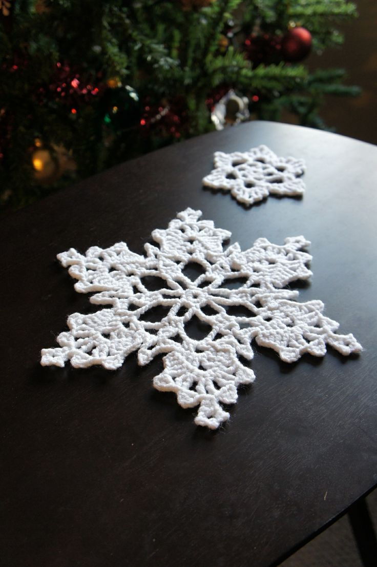Crocheted Snowflakes - I haven't found which one but the pattern is from this directory of snowflake patterns: http://www.snowcatcherphotos.com/blahg/patterns/SnowcatcherSnowflakeDirectory.html