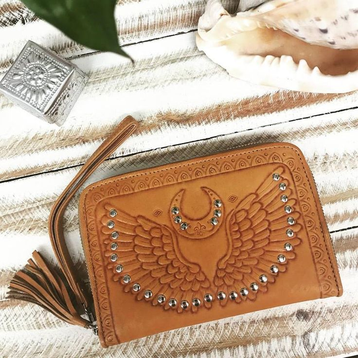 Your guiding light ✨  our new Angel Wings wallet is here and it's oh so pretty 😍  shop our new designs online now at www.mahiya.com.au.  #mahiya #angelwings #leatherwallet #handmade #handtooled #australia #goldcoast #australiafashion #festivalfashion #festivalaccessories #boho