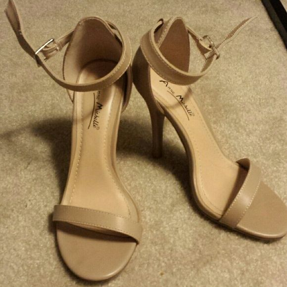 "Beige Heeled Sandals Great condition, they were only worn twice. Beautiful shoes I just don't wear them much so they're just taking up space. No flaws and only signs of wear are at the bottom of the shoes (pictured). Heel is about 4.25"" tall. Anne Michelle Shoes Heels"