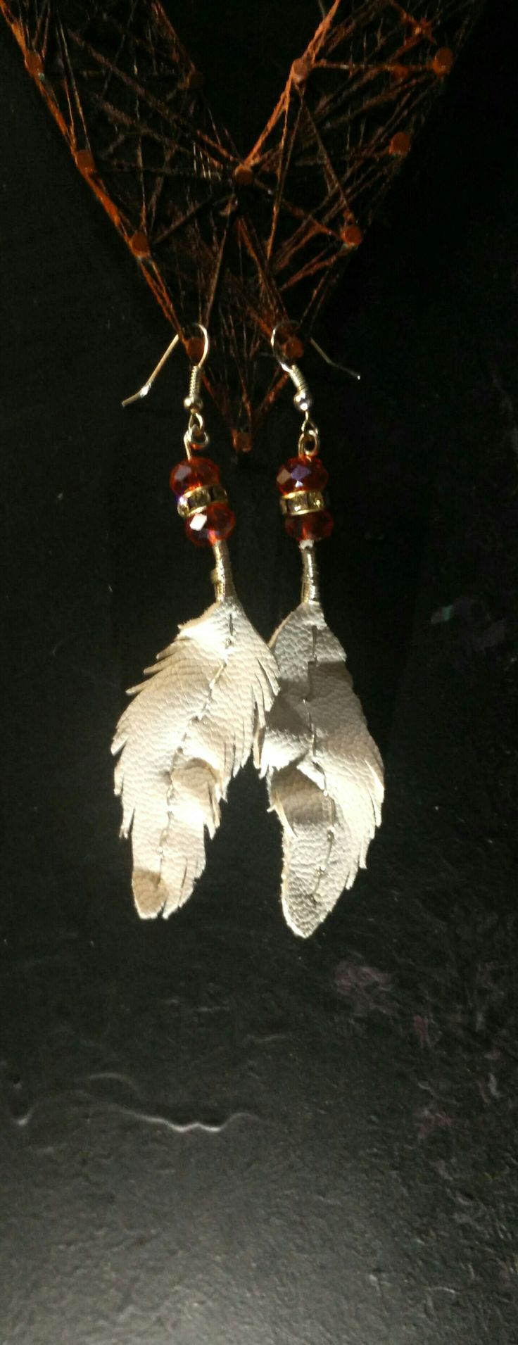 Feather earings made from leather and silver wire with gorgeous red and gold beads. Boho jewellery