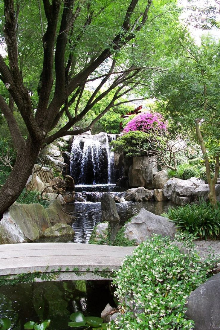 Chinese Garden A Photo From Guangdong South: Waterfall Combined With Colorful Flower And Plants For