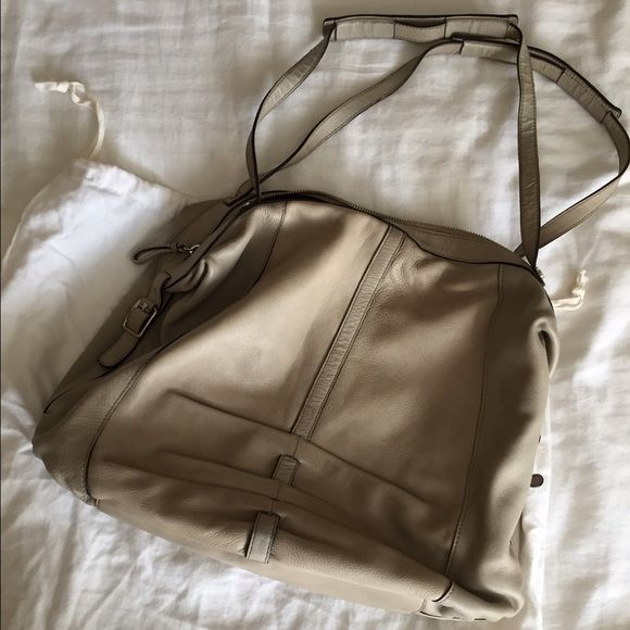 """Banana Republic Handbag Banana Republic handbag. Neutral color that coordinates with almost any outfit. Roomy and easy to carry. Comes with dust bag. Approximately 11""""h x 17""""w with one interior zipper pocket. This bag has been loved and there are signs of wear, mostly on the bottom and handles (see last photo). It's still a great bag! Please ask any questions before purchasing, thanks!  Banana Republic Bags Shoulder Bags"""
