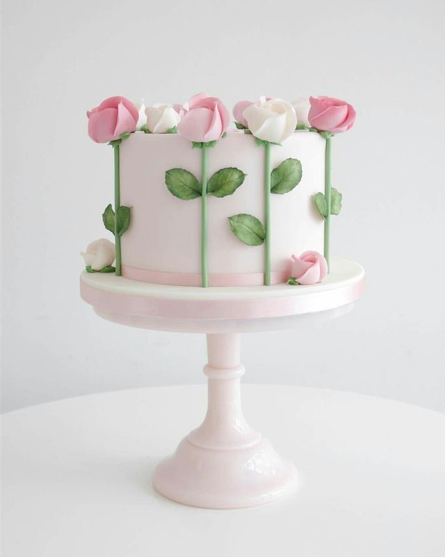 Spring cake decorated with pink and white sugar roses