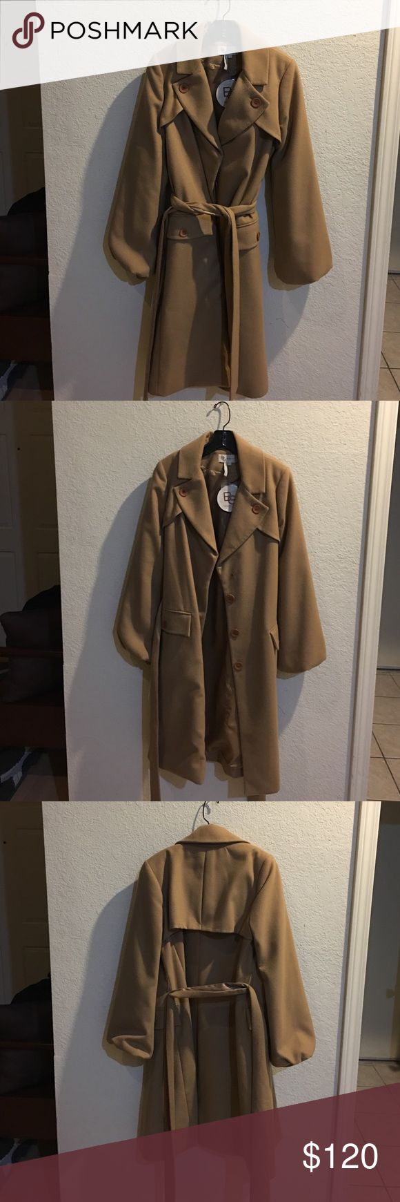 BCBGeneration Long Belted Trench Coat - NWT! - L BCBGeneration Belted Trench Coat NWT - Size L Color: Camel. Coat has bell sleeves. 70% poly 28% Rayon 2% Spandex. BCBGeneration Jackets & Coats Trench Coats