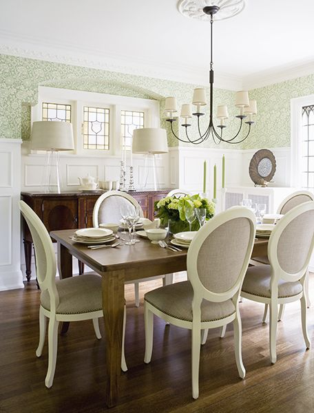 Although Pynn chose a traditional dining room arrangement with a sideboard, rectangular table, and a set of six chairs, she gave it a more casual vibe by using light linen, lots of white, and wood elements. Unless you want a formal dining room, you can use more relaxed materials and hues to make the space less prim and proper.