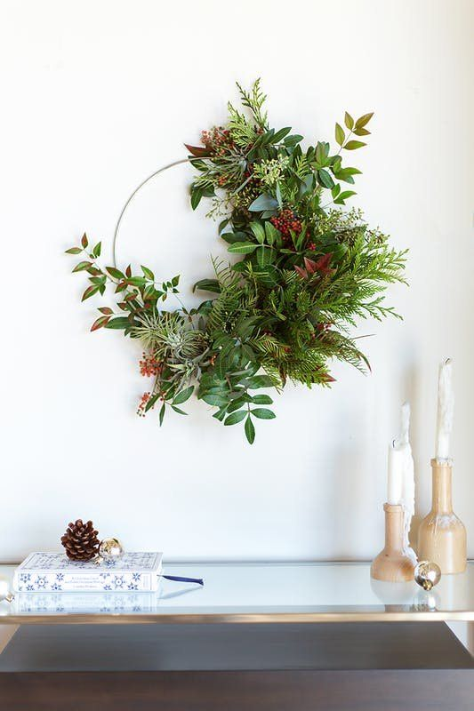 Modern Wreath Ideas: Half Wreath | Half wreaths are versatile in that they can be left simple, or embellished with as many blooms and baubles as your heart desires. Personally, I'm loving the half wreath's resemblance to those dreamy crescent moon flourishes prominently found in many Art Nouveau designs, which is why Paper & Stitch's floral-filled half wreath is one of my favorites.