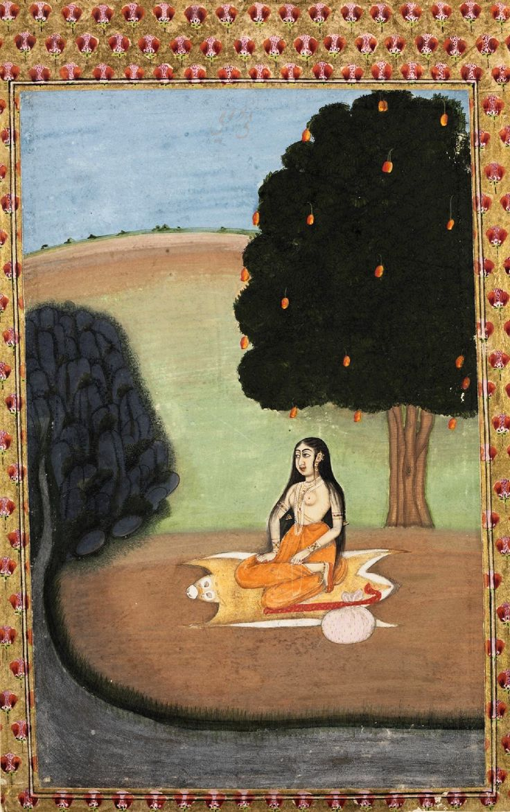 A female yogini (ascetic) is seated on a deer-skin under a mango tree by a river. Though she is wearing a saffron lower garment, she is also wearing elaborate ornaments. She has a white garland around her neck. A large white bundle together with a crook can be seen on the ground beside her. The painting portrays the musical mode gujari ragini from a Ragamala series. Place of Origin Murshidabad, India. Date c.1755 Best view: http://media.vam.ac.uk/collections/img/2014/HC/2014HC2467_2500.jp...
