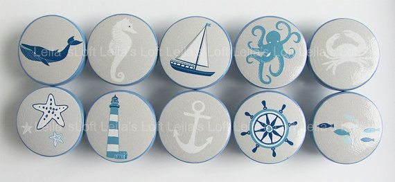 Gorgeous nautical drawer knobs in pretty shades of blue with a light gray background. Sea creature knobs including a seahorse, crab, octopus, fish,