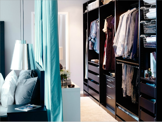 Divide the room with curtains to make a closet space. Ive done something similar to my room due to the existing small closet space. It looks great and serves its purpose... Ill pin it soon!!!