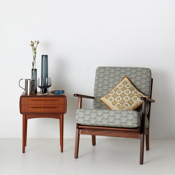Prettily-patterned fabric by Skinny LaMinx fits right in with the clean lines of this mid-century chair - #MidCentury Modern