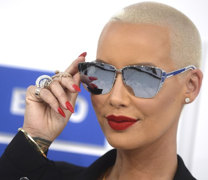 Amber Rose looked sharp in a black Tom Ford suit with wide pants at the 2016 MTV Video Music Awards held at Madison Square Garden New York City on August 28, 2016