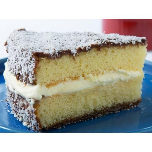 Lamington sponge cake recipe - By Woman's Day, We've added a delightful twist to the much loved Australian dessert, sandwiching light and fluffy lamingtons around a layer of fresh whipped cream.