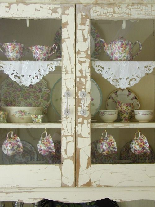 Shabby cupboard with vintage china.