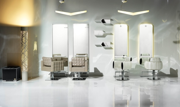 In this scene: Bolero Optima Styling Chair, Cocò White Trime Chair,  Styling Units: Free Sinua (left) Light Sinua (right), Dan Footrest, Dado Waiting Chair, Ykon Shelf on the wall