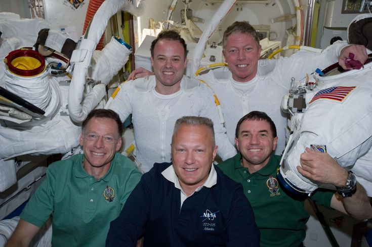 Mike Fossum (top right), five members of the joint shuttle-station crew pose for photographs in the Quest airlock of the International Space Station. Remaining inside but contributing greatly to the outside duo were, from left front, NASA astronauts Chris Ferguson, STS-135 commander, Doug Hurley, pilot, and Rex Walheim, mission specialist. Garan and Fossum are flight engineers for the station's Expedition 28 crew. Photo credit: NASA