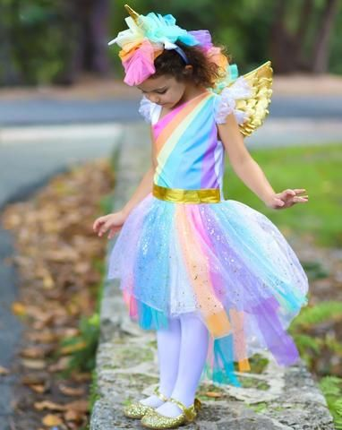 46debbf2d763 This magical fairy unicorn costume is too adorable. The dress has is cut  from soft satin fabric with a large rainbow printed in the front. The tulle  sleeve ...