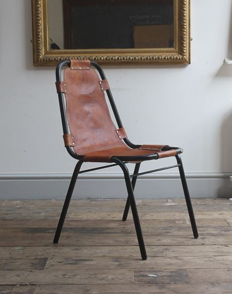 these beautifully industrial tubular steel and leather chairs were designed by french architect and designer charlotte perriand and le corbusier for the