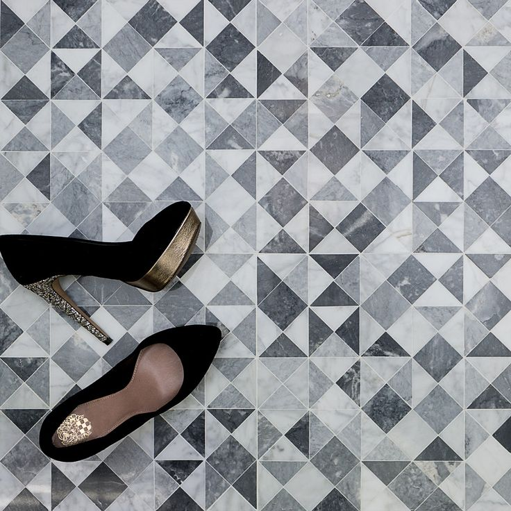"Classic Carrara and Bardiglio marble in the extremely versatile triangular pattern. Shop this tile pattern and more at TileBar.com. Krista Watterworth ""Kiss"" pictured above."