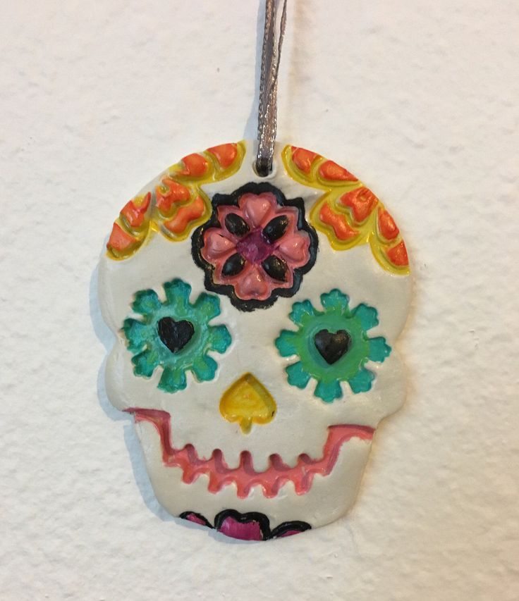 Sugar skull ornament, Day of the Dead ornament, Día de los Muertos, Christmas ornament, sugar skull decor by CreationsInTheSun on Etsy https://www.etsy.com/listing/486475513/sugar-skull-ornament-day-of-the-dead