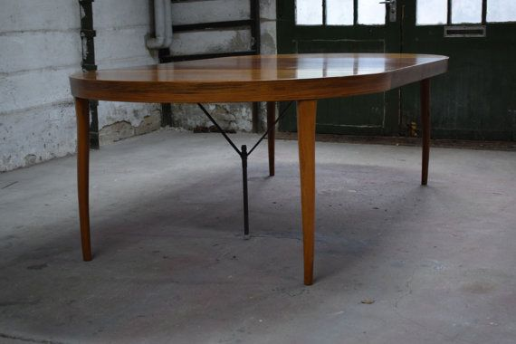Danish mid century rosewood dining table. Rosewood veneer and solig rosewood legs. Christian Linneberg. Two extension leaves, one leave with metal leg. Sticker from the manufacturer with the text Made in Denmark, 14669,By Chr. Linneberg, DANISH FURNITUREMAKERS CONTROL.  Signs of wear including faded tabletop, scratches, and small marks.  Shipping: International shipping available. Contact for a shipping quote to countries not priced in this listing, Please also contact to receive an updated…