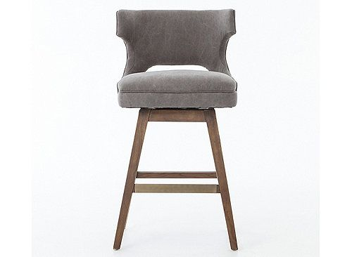 Keep it simple and comfortable with the Task swivel counter stool. Tapered legs support the cushioned seat accented with a nailhead trim. Plus, its winged back gives an elegant presence to the counter.