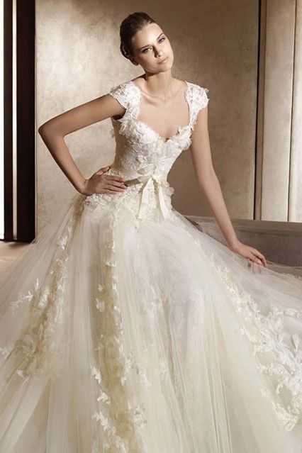 This dress appears to have a more seductive inspiration because it is closer fit to her body and has a lower neckline. But it is still done in a tasteful way so as not th